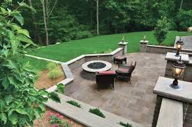 Unilock Retaining Wall Benefits Of Enclosing Your Patio With Retaining Walls Or Low Walls