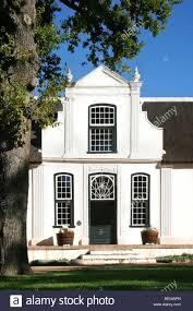 typical white cape dutch style house of vineyard bosch en dal near