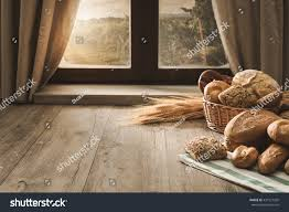 table in the kitchen fresh bread on kitchen table front stock photo 431577202