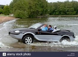 amphibious car gibb aquada amphibious car being driven out of a lake stock photo