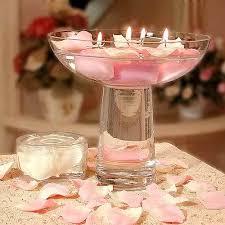 composizione di candele centrotavola e segnaposti la tavola