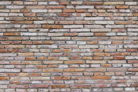 exposed brick a bare and exposed brick wall ideal for backgrounds stock photo