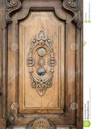 Home Door Design Download by Old Door Of Wood With Patterns Carved On It Royalty Free Stock