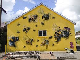a london street artist paints swarms of bees on urban walls to a london street artist paints swarms of bees on urban walls to raise awareness of colony collapse disorderby christopher jobson on march 24 2015