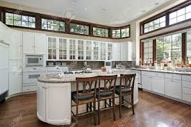 modern kitchens with white cabinets modern kitchen with white cabinets and multiple windows stock