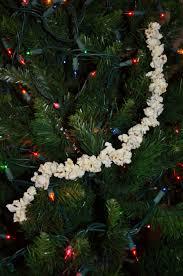12 days of kid made christmas day 2 stringing popcorn u2013 homeschool