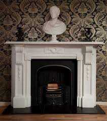 a hand carved reproduction white marble fireplace