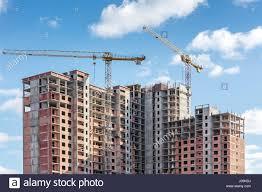 construction site high rise apartment skyscraper stock photos