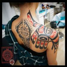 haida style bird on the shoulder top of shoulder tattoos