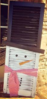 vintage window shutters repurpose tip junkie repurpose an old shutter for an easy christmas holiday decoration
