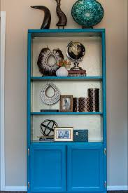 photos hgtv peacock blue bookshelf with gold interior arafen