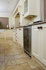 tile flooring ideas for kitchen best color of porcelain tile with white cupboards traditional