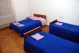 2nd dorm with 2 single beds and 1 double bed kutaisi hostel old lviv