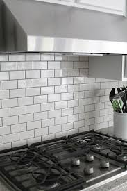 grouting kitchen backsplash gray grout with white subway tiles helps keep the kitchen from being