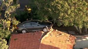 palos verdes luxury homes car lands on top of roof of palos verdes estates home u0027s garage