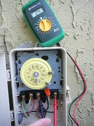 how to use a multimeter to test a pool pump motor voltage