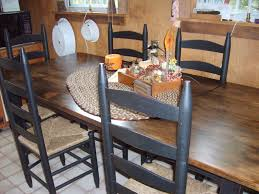 Farmhouse Style Kitchen by Kitchen Area With Black Chairs And Farmhouse Style Furniture