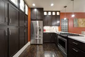 backsplash kitchen cabinets with dark floors dark kitchen