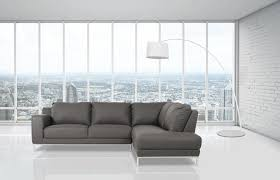 light gray sectional couch with wide chaise and short metal legs