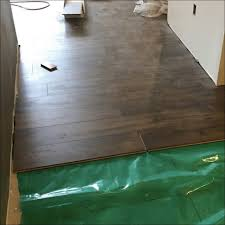 How Much To Put Down Laminate Flooring Architecture Tile Floor Installation How To Lay Down Laminate