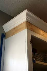 how to add crown molding to kitchen cabinets the easiest way to add trim to a cabinet builder grade moldings