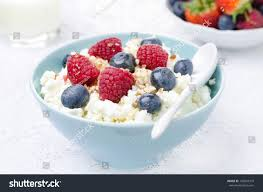 cottage cheese berries honey nuts fresh stock photo 140634319