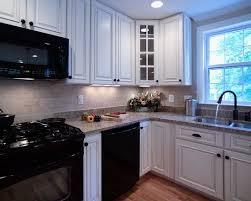 white galley kitchen with black appliances 43 best white