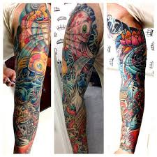 new school water tattoo men s full sleeve tattoo in a new school style with water koi fish
