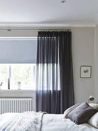 Roller Blinds Bedroom by Black Roller Blinds Behind Sheer Voiles Bedroom Curtains