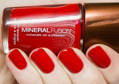 mineral fusion nail polish in brick a dark red shade with a