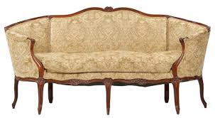 exposed wood frame sofa eye for design decorating with the french cabriole cabriolet sofa