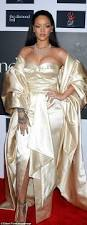 rihanna flashes cleavage in gown as she is joined by family at her
