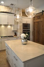 Kitchen Cabinet Labels by We Replaced The Gold Speckled Granite With A Creamy Caesarstone