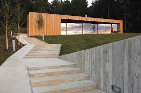 free exterior modern block house design with wood wall cladding