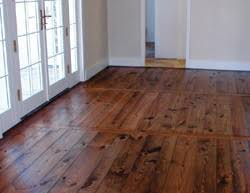 by applying a wax finish on a wood floor wood floor