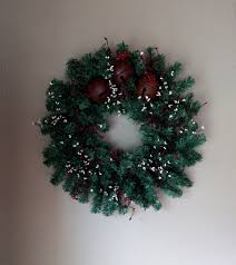 primitive wreath jingle bells and burgundy pip berries