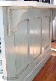 kitchen island molding add molding to builders cabinets then paint all one color easy
