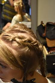 braided roll updo on stage hair design