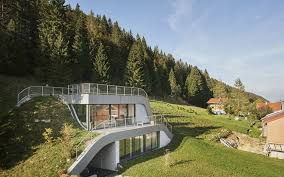homes built into hillside swooping home is partially built into a hillside house