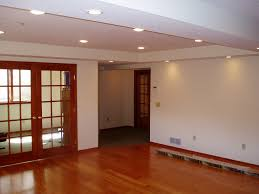 basement staircase railings and columns with carpet flooring also