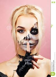 halloween pink background with drips on the face for halloween stock photo image