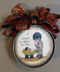 christmas tree ornament of the little drummer boy playing his drum