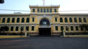 french colonial style medium close up tilt down the exterior of the saigon central post