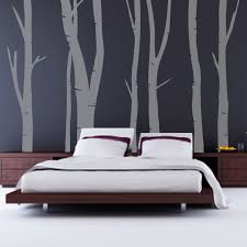 inspiring cool bedroom design with lovely tree wallpaper on dim