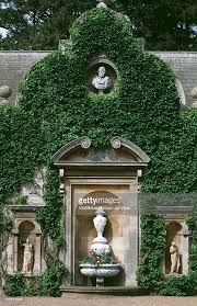 an ornamental vase and statues at belton house located in grantham