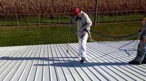 Apoc Elastomeric Roof Coating by Spraying Uniflex Elastimeric Base Coating Over Primed Metal