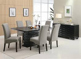 7 piece black dining table and gray upholstered chairs