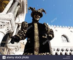 venetian jester costume in black gold jester costume venice carnival stock photo