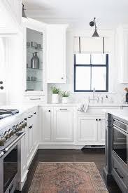 corner cabinet kitchen rug pink and beige vintage rug in front of cooktop