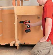 best way to install base cabinets kitchen and bathroom renovation how to install base cabinets 02